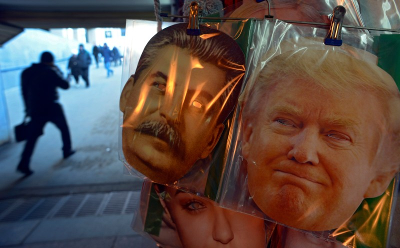 Face masks depicting Soviet leader Joseph Stalin and US President-elect Donald Trump are displayed for sale at a kiosk in an underground passage in Saint Petersburg on January 20, 2017. Donald Trump will be sworn in as the 45th president of the United States Friday -- capping his improbable journey to the White House and beginning a four-year term that promises to shake up Washington and the world. / AFP / Olga MALTSEVA        (Photo credit should read OLGA MALTSEVA/AFP/Getty Images)