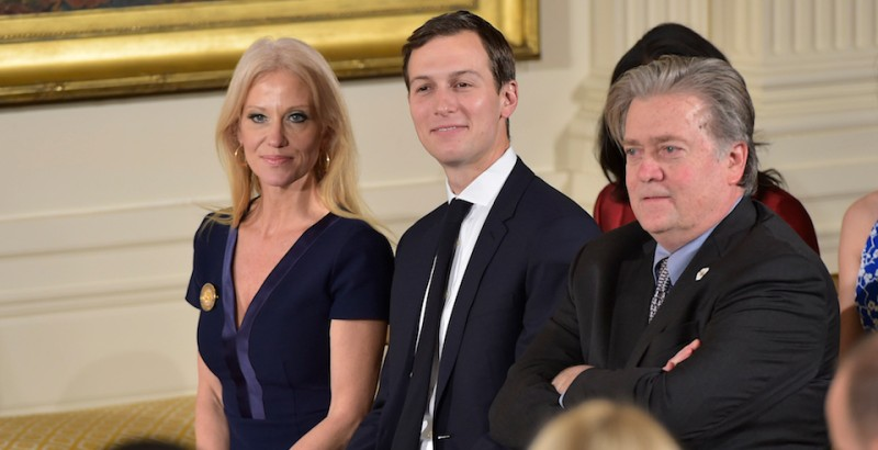 (L-R) Counselor to the President Kellyanne Conway, Senior Advisor Jared Kushner and Chief Strategist Steve Bannon attend the White House senior staff swearing in at the White House on January 22, 2017, in Washington, DC. / AFP / MANDEL NGAN        (Photo credit should read MANDEL NGAN/AFP/Getty Images)