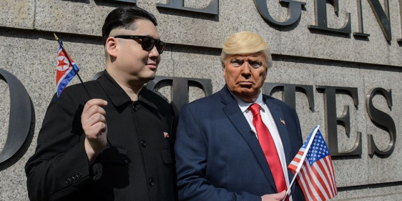 North Korean leader Kim Jong-un, impersonated by Hong Kong actor Howard (L), and US President Donald Trump, impersonated by US actor Dennis, pose outside the US consulate in Hong Kong on January 25, 2017. US President Donald Trump and North Korean leader Kim Jong-un might never be best buddies, but convincing impersonators are giving Hong Kongers a glimpse of what their improbable friendship might look like. Describing themselves as political satirists, the pair hugged and pretended to kiss as they posed for photos outside the US consulate on January 25.   / AFP / Anthony WALLACE        (Photo credit should read ANTHONY WALLACE/AFP/Getty Images)