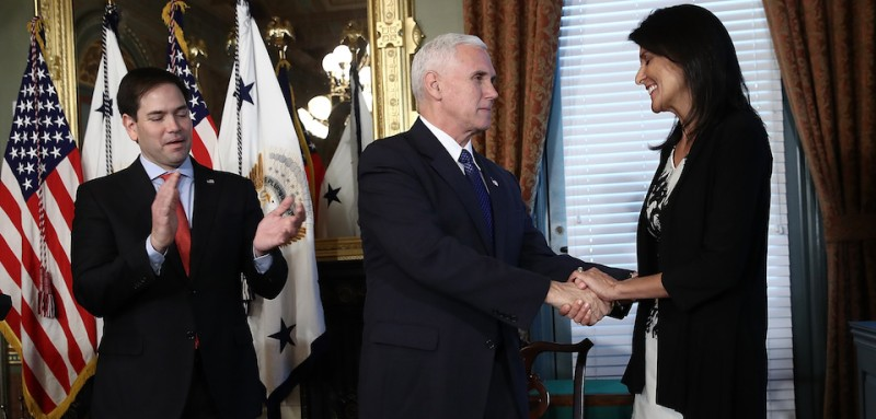 WASHINGTON, DC - JANUARY 25: (AFP-OUT)  U.S. Vice President Mike Pence (C) congratulates Nikki Haley at the end of the ceremomy where she was sworn in as the U.S. Ambassador to the United Nations January 25, 2017 in Washington, DC. Haley was formerly the Governor of South Carolina. Also pictured is Sen. Marco Rubio (R-FL).  (Photo by Win McNamee/Getty Images)