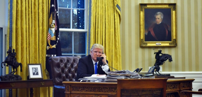 US President Donald Trump speaks on the phone with Australia's Prime Minister Malcolm Turnbull from the Oval Office of the White House on January 28, 2017, in Washington, DC. / AFP / MANDEL NGAN        (Photo credit should read MANDEL NGAN/AFP/Getty Images)