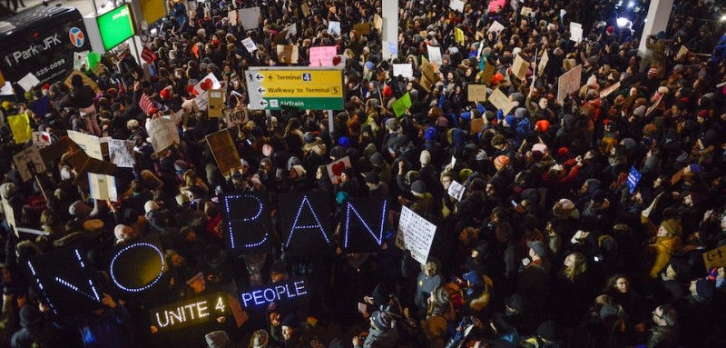 NEW YORK, NY - JANUARY 28: Protestors rally  during a demonstration against the Muslim immigration ban at John F. Kennedy International Airport on January 28, 2017 in New York City. President Trump signed the controversial executive order that halted refugees and residents from predominantly Muslim countries from entering the United States. (Photo by Stephanie Keith/Getty Images)
