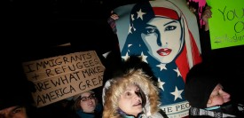 TOPSHOT - Demonstrators protest President Donald Trump's executive immigration ban at O'Hare International Airport on January 29, 2017 in Chicago, Illinois. US President Trump signed the controversial executive order that halted refugees and residents from predominantly Muslim countries from entering the United States.  / AFP / Joshua LOTT        (Photo credit should read JOSHUA LOTT/AFP/Getty Images)