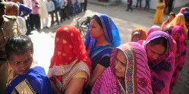 Indian women wait in a queue for their turn to vote at a polling station in the Naini area on the outskirts of Allahabad during the fourth phase of Uttar Pradesh state assembly elections on February 23, 2017. Uttar Pradesh is home to over 200 million people -- more than the entire population of Brazil -- and polls in the battleground state are a bellwether of national politics. / AFP / SANJAY KANOJIA        (Photo credit should read SANJAY KANOJIA/AFP/Getty Images)