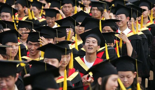 SHANGHAI, CHINA - JUNE 20: (CHINA OUT; PHOTOCOME OUT) Graduates attend a graduation ceremony at Shanghai Jiaotong University on June 20, 2005 in Shanghai, China. According to the Ministry of Education, about 3.38 million college students will graduate this summer, 580,000 more than last year. Graduates face fierce job competition, as the number of graduates leaving colleges and universities have increased since 1999. (Photo by China Photos/Getty Images)