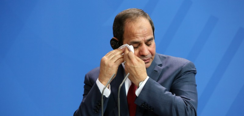 BERLIN, GERMANY - JUNE 03:  Egyptian President Abdel Fattah el-Sisi wipes his brow during a news conference with German Chancellor Angela Merkel (unseen) on June 3, 2015 in Berlin, Germany. The meeting between the two leaders was intended to increase economic and security cooperation between their two countries, which shared 4.4 billion euros ($4.8 billion) in bilateral trade in 2014. The two disagreed over human rights issues such as capital punishment.  (Photo by Adam Berry/Getty Images)