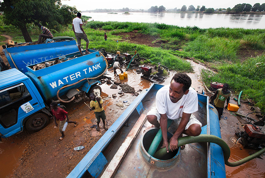 Truck drivers collect water directly from the Nile river on March 21, 2017, to distribute to residents for drinking consumption in Juba, South Sudan. International World Water Day is marked annually on March 22 to focus global attention on the importance of water. / AFP PHOTO / ALBERT GONZALEZ FARRAN        (Photo credit should read ALBERT GONZALEZ FARRAN/AFP/Getty Images)