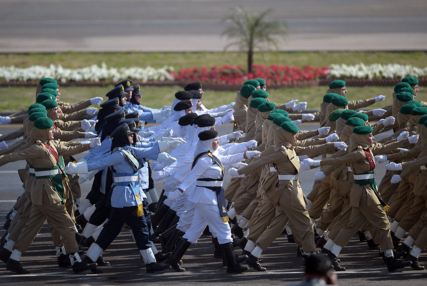 TOPSHOT - Female soldiers of Pakistan's Air Force, Navy and Army march past during a Pakistan Day military parade in Islamabad on March 23, 2017.   Pakistan National Day commemorates the passing of the Lahore Resolution, when a separate nation for the Muslims of The British Indian Empire was demanded on March 23, 1940. / AFP PHOTO / AAMIR QURESHI        (Photo credit should read AAMIR QURESHI/AFP/Getty Images)