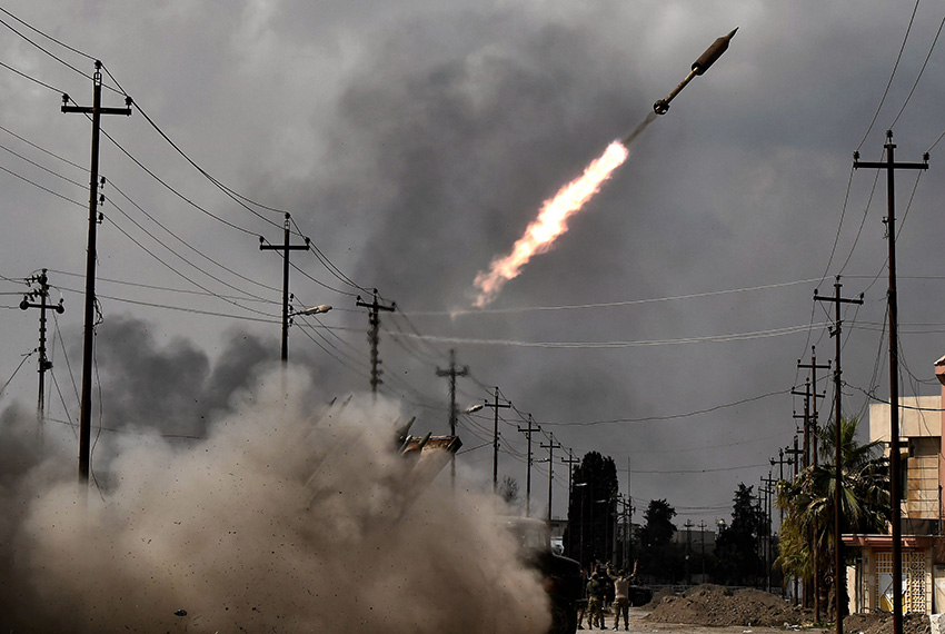 TOPSHOT - Iraqi government forces fire a rocket towards Islamic State (IS) group positions in west Mosul on March 14, 2017, as they continue to advance in the embattled city combatting the jihadists. Baghdad's forces launched a major drive last month to oust the Islamic State group from west Mosul, a battle that has pushed more than 80,000 people to flee their homes in less than three weeks. / AFP PHOTO / ARIS MESSINIS        (Photo credit should read ARIS MESSINIS/AFP/Getty Images)