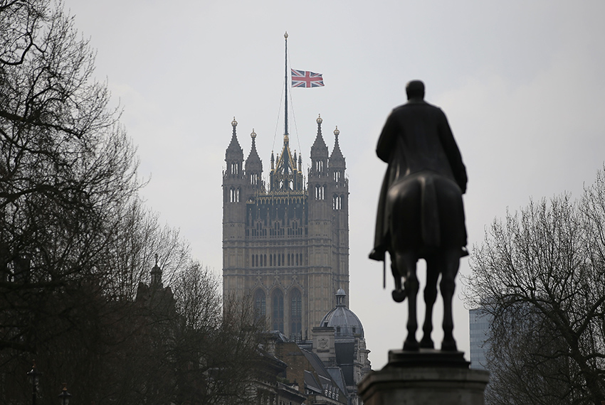 TOPSHOT - A Union flag flies at half mast from the Houses of Parliament on March 23, 2017. Seven people have been arrested including in London and Birmingham over Wednesday's terror attack at the British parliament, the police said today, revising down the number of victims to three people. / AFP PHOTO / Daniel LEAL-OLIVAS        (Photo credit should read DANIEL LEAL-OLIVAS/AFP/Getty Images)