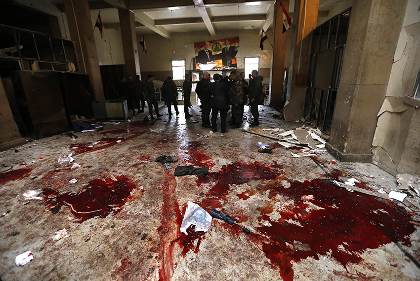 TOPSHOT - Syrian security forces inspect the scene of a reported suicide bombing at the old palace of justice building in Damascus on March 15, 2017. Two suicide bombings hit Damascus including the attack at the central courthouse that left at least 32 dead, as Syria's war entered its seventh year with the regime now claiming the upper hand. / AFP PHOTO / Louai Beshara        (Photo credit should read LOUAI BESHARA/AFP/Getty Images)