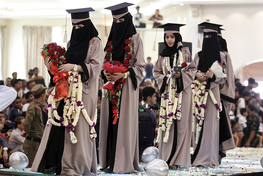 TOPSHOT - Female Yemeni university students attend a graduation ceremony in the capital Sanaa on March 21, 2017. / AFP PHOTO / Mohammed HUWAIS        (Photo credit should read MOHAMMED HUWAIS/AFP/Getty Images)