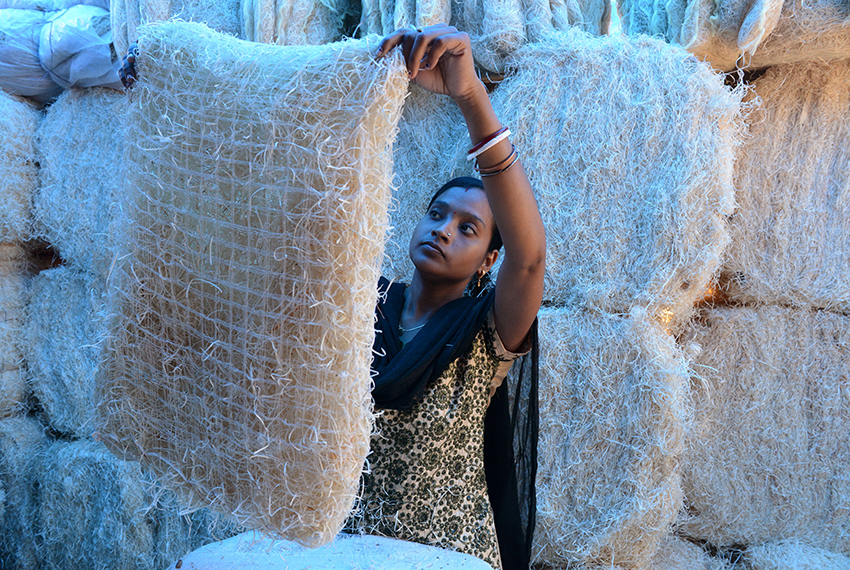 TOPSHOT - An Indian worker inspects a pad made of shredded wood fibre at an air cooler factory in Hyderabad on March 23, 2017. Air coolers, with their moistened fibre pads and electric powered fans are used extensively in the summer months across the Indian subcontinent as temperatures rise above 40 degrees celsius in many areas. / AFP PHOTO / NOAH SEELAM        (Photo credit should read NOAH SEELAM/AFP/Getty Images)