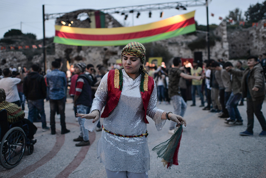 TOPSHOT - Kurdish community members living in Greece dance during Newroz celebrations on March 21, 2017 in Lavrio, some 80 kilometres from Athens.  Kurds celebrate Newroz every year on the first day of spring, March 21, and is considered the most important festival in Kurdish culture.  / AFP PHOTO / Eleftherios Elis        (Photo credit should read ELEFTHERIOS ELIS/AFP/Getty Images)