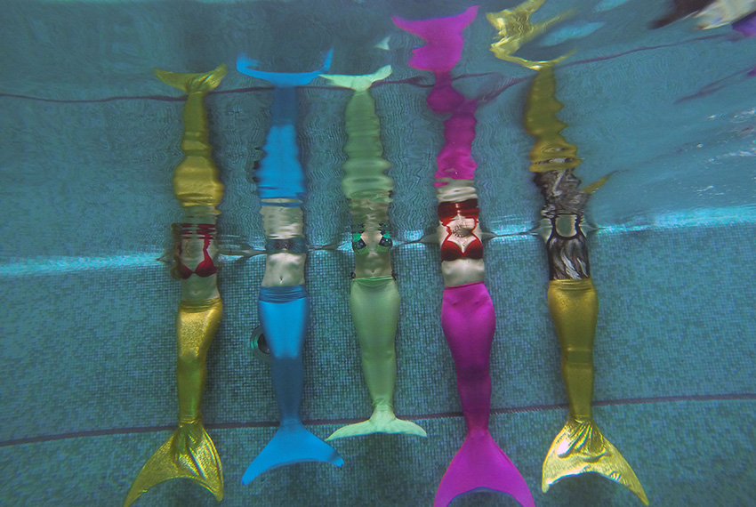 TOPSHOT - A picture taken on March 16, 2017 shows women practicing swimming with mermaid tails at a mermaid training school in a pool in Moscow. Russian women who have dreamt of becoming a mermaid since their youngest years, start turning their fantasies into reality with a new type of fitness  mermaid swimming. / AFP PHOTO / Natalia KOLESNIKOVA        (Photo credit should read NATALIA KOLESNIKOVA/AFP/Getty Images)
