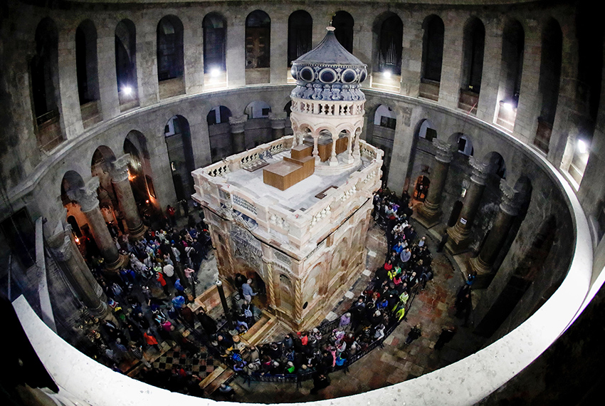 TOPSHOT - A picture taken on March 21, 2017 at the Church of the Holy Sepulchre in the Old City of Jerusalem shows the renovated Edicule of the Tomb of Jesus (where his body is believed to have been laid). The tomb is being unveiled again following nine months of restoration work that will be highlighted at a much  anticipated ceremony on March 22, 2017. The shrine, which includes a 19th-century ornate edicule or shrine surrounding the tomb, is a key part of the Church in Jerusalem's Old City. / AFP PHOTO / THOMAS COEX        (Photo credit should read THOMAS COEX/AFP/Getty Images)