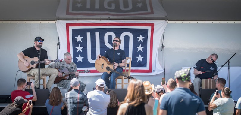 Country music star Craig Morgan, with band and guest musician U.S. Air Force Gen. Paul J. Selva, Vice Chairman of the Joint Chiefs of Staff, perform a song during a USO show at Joint Base Pearl Harbor-Hickam, Hawaii, March 25, 2017. Gen. Selva, along with USO entertainers, visited service members who are stationed outside the continental U.S. at various locations across the globe.  This year's entertainers included mixed-martial artist Dominick Cruz, chef Robert Irvine, U.S. Olympic Swimmer Katie Meili, and mentalist Jim Karol. (DoD Photo by U.S. Army Sgt. James K. McCann)