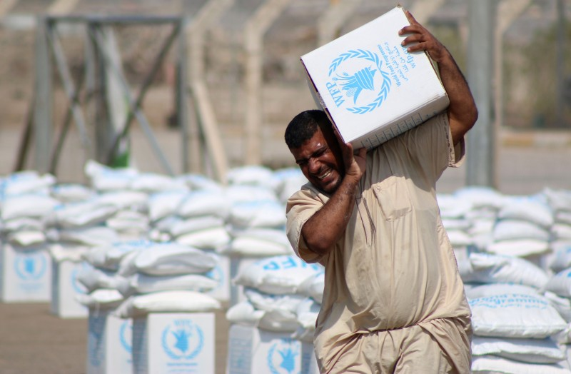 Displaced Iraqis, who fled their homes following an offensive led by the Islamic State (IS) jihadist group, collect boxes of food donated by the World Food Program (WFP) in the southern city of Basra on October 2, 2014.  United Nations agencies are running out of funding to help the 1.8 million people displaced by violence in Iraq, UN humanitarian chief Valerie Amos said.  AFP PHOTO/HAIDAR MOHAMMED ALI        (Photo credit should read HAIDAR MOHAMMED ALI/AFP/Getty Images)