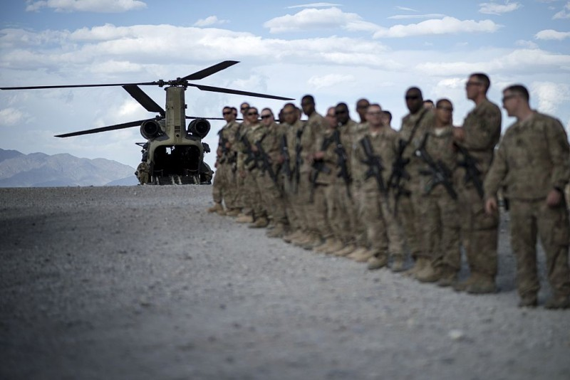 To go with Afghanistan-unrest-US-military-veterans-health,FOCUS by Daniel De Luce This photo taken on May 28, 2014 shows US soldiers lining up as they wait to bid farewell to wounded veterans during 'Operation Proper Exit' at Forward Operating Base Shank in Afghanistan's Logar Province.   Washington is winding down its 32,000 troop deployment in Afghanistan after nearly 13 years of war, with President Barack Obama announcing this week that all US forces will leave by the end of 2016. While an end is now in sight for America's longest war, many of the more than 19,000 Americans wounded in Afghanistan will be coping with injuries for years to come.   AFP PHOTO/Brendan SMIALOWSKI        (Photo credit should read BRENDAN SMIALOWSKI/AFP/Getty Images)