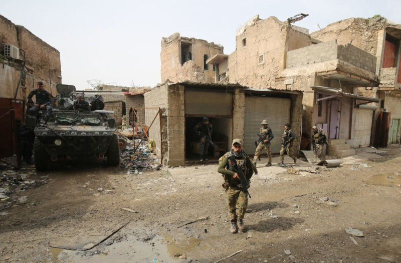 Iraqi forces, consisting of the Iraqi federal police and the elite Rapid Response Division, hold a position as they advance in the Old City in western Mosul on March 19, 2017, during the offensive to retake the city from Islamic State (IS) group fighters. / AFP PHOTO / AHMAD AL-RUBAYE        (Photo credit should read AHMAD AL-RUBAYE/AFP/Getty Images)