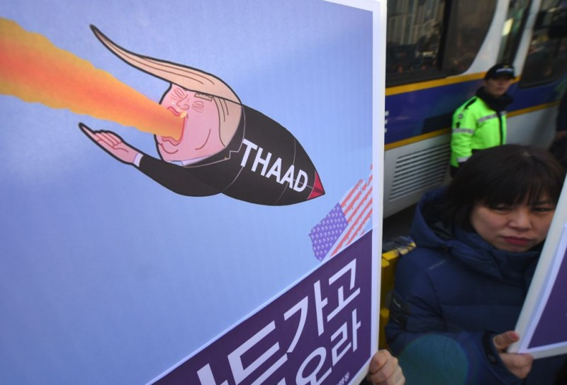 South Korean protesters hold placards showing a caricature of US President Donald Trump during a rally against the planned deployment of the US-built Terminal High Altitude Area Defense (THAAD) anti-ballistic missile system, outside the Defence Ministry in Seoul on February 28, 2017. Residents living near a South Korean golf course on February 28 sued to stop it becoming the site of a controversial US missile system loathed by Beijing, their lawyers said as Chinese media poured scorn on the plan. / AFP / JUNG Yeon-Je        (Photo credit should read JUNG YEON-JE/AFP/Getty Images)