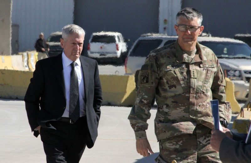 The new Pentagon chief and US Secretary of Defence, James Mattis (L), is welcomed by Lieutenant General Stephen Townsend? upon his arrival in the Iraqi capital Baghdad, on February 20, 2017. The United States is not about to plunder Iraq's petroleum reserves, Defence Secretary Jim Mattis, who arrived in Baghdad, said as he sought to soothe partners rattled by President Donald Trump.  / AFP / Thomas WATKINS        (Photo credit should read THOMAS WATKINS/AFP/Getty Images)