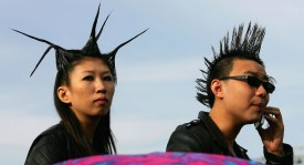 BEIJING - OCTOBER 02: Chinese teenager attend a rock-and-roll festival to mark Chinese National Day on October 2, 2005 in Beijing, China. Various activities are being held in China to mark the National Day.  (Photo by Guang Niu/Getty Images)