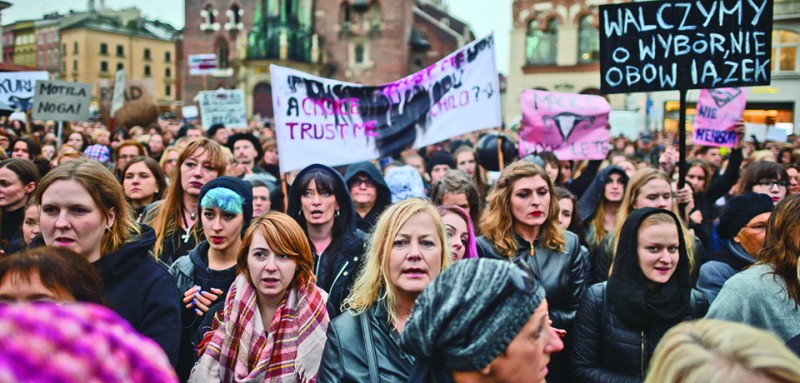 Thousands of women Pro-Choice protesters on Debnicki Square, in Krakow, during a 'Black protest'. Women nationwide strike took place all around the country and it is the response against the proposed tightening of the law on abortion in Poland. Polish women are demanding respect for their right to free choice and the freedom to decide about their own bodies and lives. On Monday, 3 October 2016, in Krakow, Poland. (Photo by Artur Widak/NurPhoto via Getty Images)