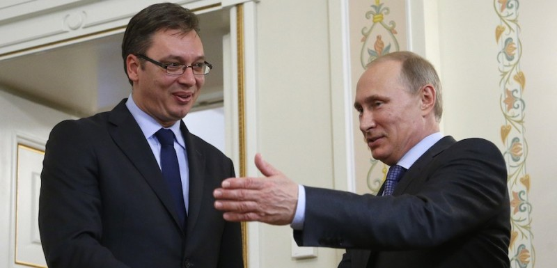 Russia's President Vladimir Putin (R) invites for talks Serbian Prime Minister Aleksandar Vucic (L) during their meeting in the Novo-Ogaryovo residence, outside Moscow, on July 8, 2014. Russia and Serbia are ready to start procedures of signing an agreement on the South Stream gas pipeline in the next few days, the Itar-TASS news agency quoted Russia's Prime Minister Dmitry Medvedev as saying yesterday after his talks with Vucic. The 16-billion-euro ($21.8 billion) South Stream pipeline would stretch nearly 2,500 kilometres (1,500 miles) from Russia under the Black Sea to Bulgaria, Serbia, Hungary and Slovenia before reaching a terminal in Italy. It is an attempt to reduce Moscow's reliance on Ukraine as a transit country for its natural gas following disputes with Kiev in 2006 and 2009 that led to interruptions of gas supplies to Europe. AFP PHOTO / POOL/ MAXIM SHIPENKOV        (Photo credit should read MAXIM SHIPENKOV/AFP/Getty Images)