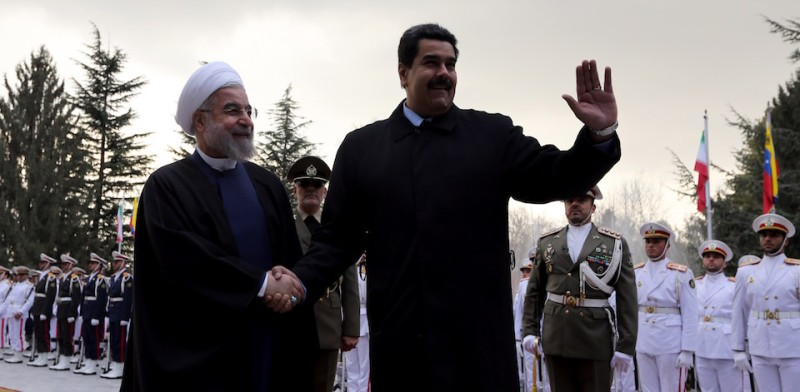 Iranian President Hassan Rouhani (L) shakes hands with Venezuelan President Nicolas Maduro after reviewing the honor guard at the Saadabad Palace in Tehran on January 10, 2015. Maduro arrived in the Iranian capital the previous day for a 24-hour visit during which he will meet officials from fellow OPEC member Iran to discuss plunging oil prices, state television said. AFP PHOTO/ATTA KENARE        (Photo credit should read ATTA KENARE/AFP/Getty Images)