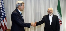 Iranian Foreign Minister Mohammad Javad Zarif (R) shakes hands on January 14, 2015 with US State Secretary John Kerry in Geneva. Zarif said on January 14 that his meeting with his US counterpart was vital for progress on talks on Tehran's contested nuclear drive. Under an interim deal agreed in November 2013, Iran's stock of fissile material has been diluted from 20 percent enriched uranium to five percent, in exchange for limited sanctions relief.   AFP PHOTO / POOL / RICK WILKING        (Photo credit should read RICK WILKING/AFP/Getty Images)