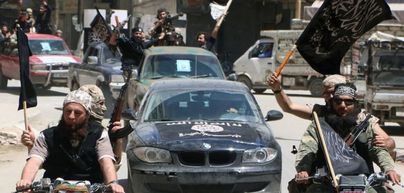 Fighters from Al-Qaeda's Syrian affiliate Al-Nusra Front drive in the northern Syrian city of Aleppo flying Islamist flags as they head to a frontline, on May 26, 2015. Once Syria's economic powerhouse, Aleppo has been divided between government control in the city's west and rebel control in the east since shortly after fighting there began in mid-2012. AFP PHOTO / AMC / FADI AL-HALABI        (Photo credit should read Fadi al-Halabi/AFP/Getty Images)