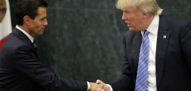 TOPSHOT - Mexican President Enrique Pena Nieto (L) and US presidential candidate Donald Trump shake hands after a meeting in Mexico City on August 31, 2016. Donald Trump was expected in Mexico Wednesday to meet its president, in a move aimed at showing that despite the Republican White House hopeful's hardline opposition to illegal immigration he is no close-minded xenophobe. Trump stunned the political establishment when he announced late Tuesday that he was making the surprise trip south of the border to meet with President Enrique Pena Nieto, a sharp Trump critic.  / AFP / YURI CORTEZ        (Photo credit should read YURI CORTEZ/AFP/Getty Images)