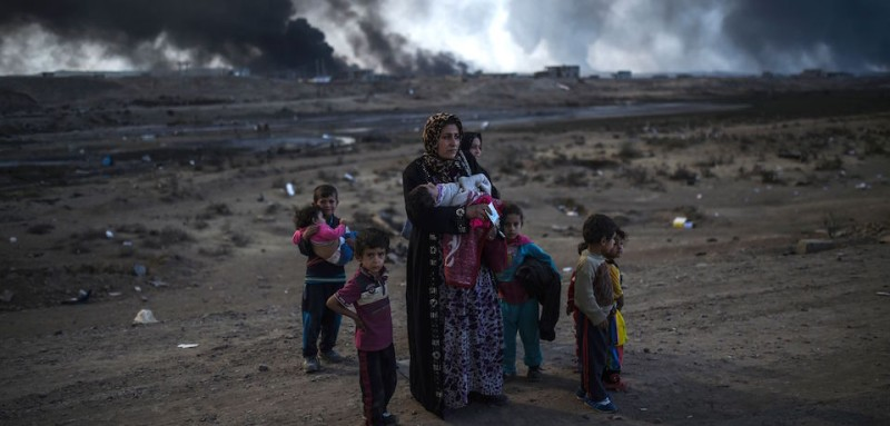Iraqi families who were displaced by the ongoing operation by Iraqi forces against jihadists of the Islamic State group to retake the city of Mosul, are seen near Qayyarah, south of Mosul, on October 29, 2016. Iraqi paramilitary forces launched an operation to cut the Islamic State group's supply lines between its Mosul bastion and neighbouring Syria, opening a new front in the nearly two-week-old offensive. / AFP / BULENT KILIC        (Photo credit should read BULENT KILIC/AFP/Getty Images)