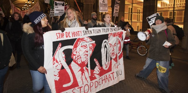 Demonstrators protest in Amsterdam in front of the US Consulate on January 20, 2017 after the inauguration of President-elect Donald Trump in Washington, DC.   Donald Trump was sworn in as the 45th president of the United States Friday -- capping his improbable journey to the White House and beginning a four-year term that promises to shake up Washington and the world. / AFP / ANP / Olaf KRAAK / Netherlands OUT        (Photo credit should read OLAF KRAAK/AFP/Getty Images)