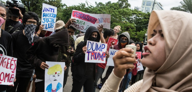 JAKARTA, INDONESIA - FEBRUARY 04: Protesters hold a symbol during a rally against President Donald Trump on February 4, 2017 in Jakarta, Indonesia. U.S. President Trump signed an executive order last week banning immigration to the USA from seven Muslim countries which led to protests across America, Europe and Asia, to denounce the travel ban. (Photo by Oscar Siagian/Getty Images)
