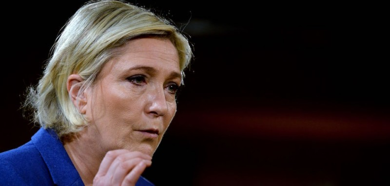 French far-right Front National (FN) party candidate for the presidential election Marine Le Pen gestures as she speaks during a debate at the French Confederation of Small and Medium-Sized Enterprises (CPME) union's headquarters in Puteaux, near Paris on March 6, 2017. / AFP PHOTO / ERIC PIERMONT        (Photo credit should read ERIC PIERMONT/AFP/Getty Images)