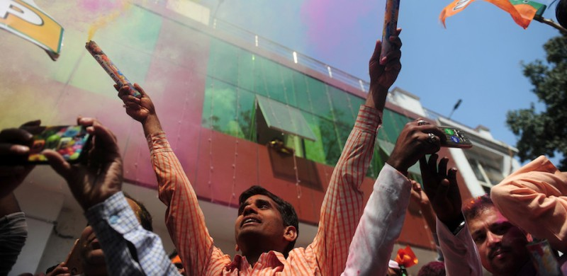 "Indian supporters of the Bharatiya Janata Party (BJP) celebrate outside the party office as state assembly votes are counted in Lucknow on March 11, 2017. Prime Minister Narendra Modi's Bharatiya Janata Party claimed election victory in four Indian states, calling it a ""historic mandate"" that would take the country's politics in a new direction. / AFP PHOTO / SANJAY KANOJIA        (Photo credit should read SANJAY KANOJIA/AFP/Getty Images)"