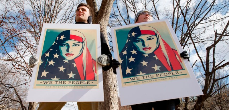 Demonstrators gather near The White House to protest President Donald Trump's travel ban on six Muslim countries on March 11, 2017 in Washington, DC.  / AFP PHOTO / Tasos Katopodis        (Photo credit should read TASOS KATOPODIS/AFP/Getty Images)