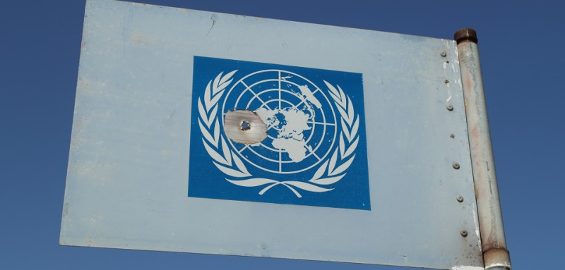 DUCZE, CYPRUS - MARCH 06:  A United Nations metal flag with a bullet hole in it stands on a U.N. peacekeepers' viewing platform near a militarized zone of the Turkish Republic of North Cyprus (TRNC) next to the British Soverign Base Area on March 6, 2017 near Duzce, Cyprus. Cyprus has been divided into a Greek south and Turkish north ever since the brief but devastating war of 1974. Since then United Nations peacekeepers have maintained a buffer zone that runs through the capital city of Nicosia and across the entire island to keep the factions apart. In the south the Greek-dominated Republic of Cyprus is internationally-recognized and a member of the European Union, while in the north the self-proclaimed Turkish Republic of North Cyprus (TRNC) is recognized only by Turkey, which also has tens of thousands of troops stationed there. Negotiations over possible reunification have made strident progress over the last few years, though they have stalled in recent months. Britain maintains two military bases on the southern part of the island that it controls as soverign territory.  (Photo by Sean Gallup/Getty Images)