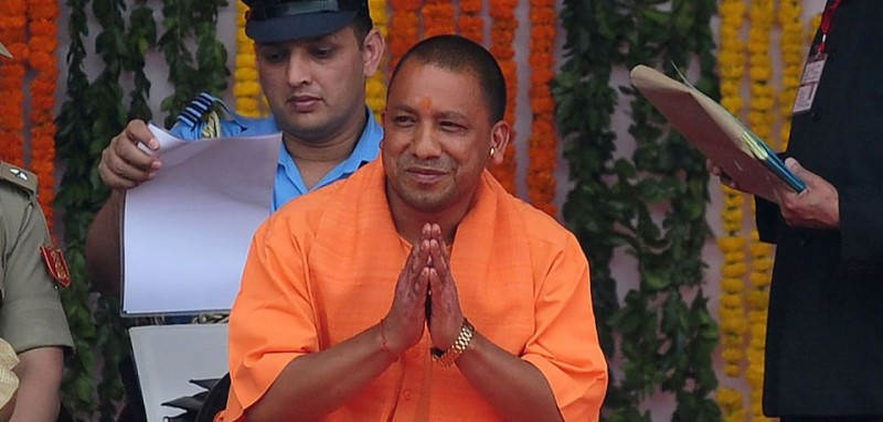 Yogi Adityanath (C), Uttar Pradesh's new chief minister, attends his swearing-in ceremony in Lucknow on March 19, 2017. Prime Minister Narendra Modi's right-wing party on March 18 picked a controversial firebrand leader to head India's most populous state, where it won a landslide victory last week. After an hours-long meeting with local BJP legislators, senior party leader M. Venkaiah Naidu announced 44-year-old Yogi Adityanath as Uttar Pradesh's next chief minister.  / AFP PHOTO / SANJAY KANOJIA        (Photo credit should read SANJAY KANOJIA/AFP/Getty Images)