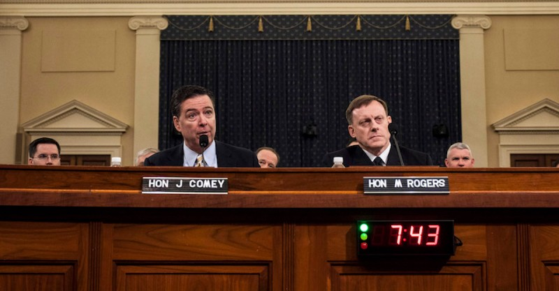 WASHINGTON, D.C. - MARCH 20:  (L-R) James Comey, Director of the Federal Bureau of Investigation (FBI), and Michael Rogers, Director of the National Security Agency, testify during a House Permanent Select Committee on Intelligence hearing concerning Russian meddling in the 2016 United States election, on Capitol Hill, March 20, 2017 in Washington, DC. While both the Senate and House Intelligence committees have received private intelligence briefings in recent months, Monday's hearing is the first public hearing on alleged Russian attempts to interfere in the 2016 election. (Photo by Zach Gibson/Getty Images)