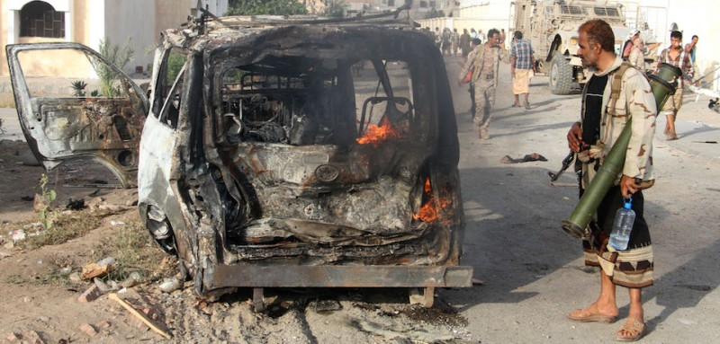 EDITORS NOTE: Graphic content / A Yemeni man looks at a burning vehicle following a reported suicide car bombing in Huta, the capital of the southern province of Lahj, a bastion of Al-Qaeda jihadists, on March 27, 2017. Ten jihadists, including a suicide bomber, perished when they attacked a government building in southern Yemen, killing six soldiers and four civilians, officials said.  / AFP PHOTO / SALEH AL-OBEIDI        (Photo credit should read SALEH AL-OBEIDI/AFP/Getty Images)