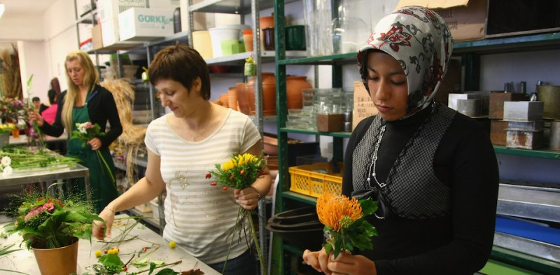BERLIN - SEPTEMBER 05:  Young women training to become florists, including a Muslim woman wearing a headscarf, bundle flower bouquets shortly before the arrival of German Chancellor Angela Merkel at the BildungsWerk Kreuzberg, a vocational training school in the immigrant-heavy district of Kreuzberg, on September 5, 2008 in Berlin, Germany. Merkel is visiting schools across Germany in order to get a better unserstanding of the state of Germany's education system.  (Photo by Sean Gallup/Getty Images)