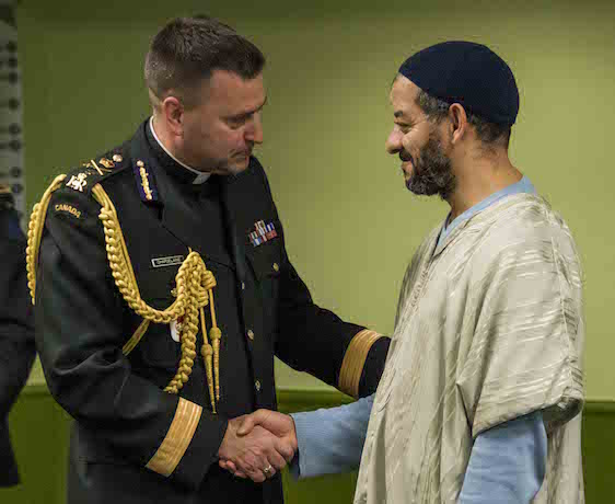 Brigadier-General Guy Chapdelaine (left)  and Iman of  the Islamic Quebec Cultural Center (IQCC) socialize during Operation Solidarity at the IQCC on February 24, 2017.  Photo: Corporal Eric Girard, Canadian Forces Combat Camera IS07-2017-0002-013  ~ Brigadier-General Guy Chapdelaine (gauche)  et Iman socialise au Centre culturel islamique de Québec (CCIQ) durant Opération Solidarité au CCIQ le24 février 2017.  Photo: Caporal Eric Girard, Caméra de combat des Forces canadiennes IS07-2017-0002-013