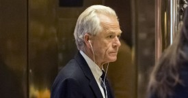 "University of California at Irvine Economics Professor Peter Navarro, head of White House National Trade Council nominee for president-elect Donald Trump, arrives in the lobby of Trump Tower in New York, U.S., on Thursday, Jan. 5, 2017. A top congressional ally to Trump said Thursday that Republicans will repeal Obamacare, including some funding provisions, quickly while a replacement plan is due in ""six to eight months."" Photographer: Albin Lohr-Jones/Pool via Bloomberg"