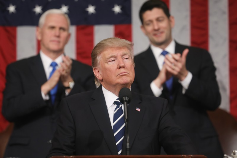 WASHINGTON, DC - FEBRUARY 28:  (AFP OUT) U.S. President Donald J. Trump (C) delivers his first address to a joint session of the U.S. Congress as U.S. Vice President Mike Pence (L) and Speaker of the House Paul Ryan (R) listen on February 28, 2017 in the House chamber of the U.S. Capitol in Washington, DC. Trump's first address to Congress focused on national security, tax and regulatory reform, the economy, and healthcare. (Photo by Jim Lo Scalzo - Pool/Getty Images)