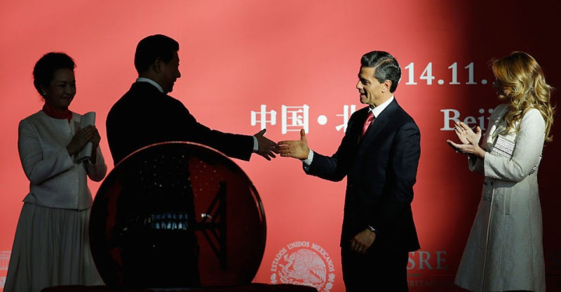 "BEIJING, CHINA - NOVEMBER 13:  Mexico's President Enrique Pena Nieto (2nd R) shakes hands with China's President Xi Jinping (2nd L) as he and his wife Angelica Rivera (R), Xi's wife Peng Liyuan (L) attend the opening ceremony of the exhibition ""Mayas: The Language of Beauty"" at the National Museum of China on November 13, 2014 in Beijing, China. (Photo by Jason Lee-Pool/Getty Images)"