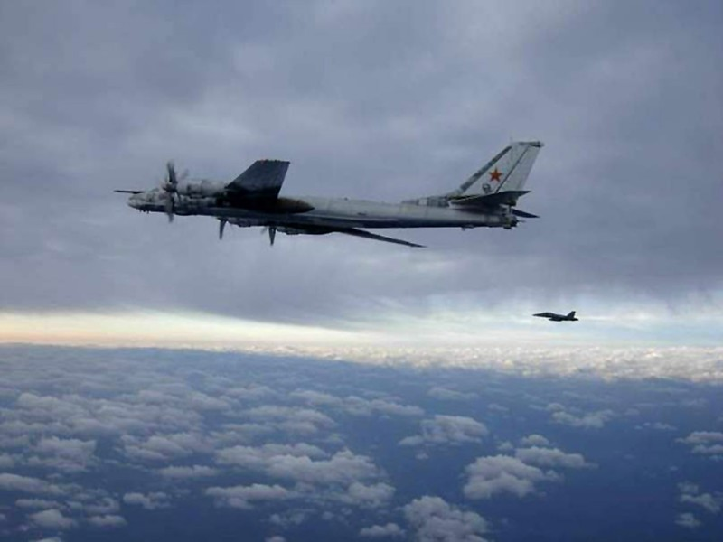 In this U.S. Navy handout, a F/A-18 Hornet strike fighter intercepts one of two Russian Tu-95 Bear long rang bomber aircraft as it approached the U.S. Navy aircraft carrier USS Nimitz  February 9, 2008 south of Japan.  Fighter planes escorted the bomber out of the area. Nimitz was transiting through the Western Pacific on a regularly scheduled deployment when the incident occurred.  (Photo by U.S. Navy via Getty Images)