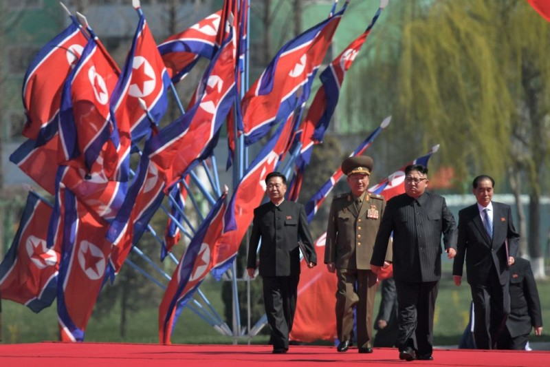 North Korea's leader Kim Jong-Un (2nd R) attends a ceremony for the opening of a housing project in Pyongyang on April 13, 2017. With thousands of adoring North Koreans looking on -- along with invited international media -- Kim Jong-Un opened a prestige housing project as he seeks to burnish his nation's image even as concerns over its nuclear capabilities soar. / AFP PHOTO / Ed JONES        (Photo credit should read ED JONES/AFP/Getty Images)